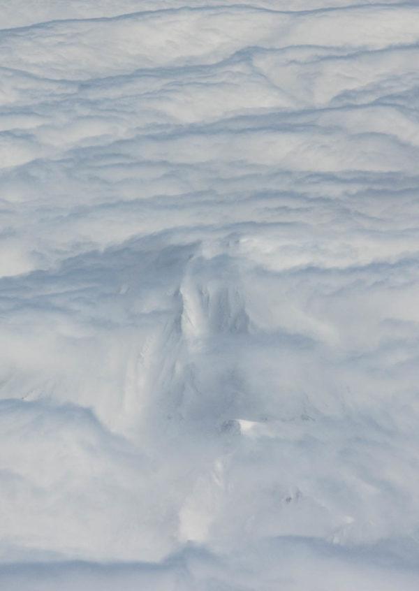 Hide-and-seek. Flying over Bakening volcano, Ganalsky range, Kamchatka.