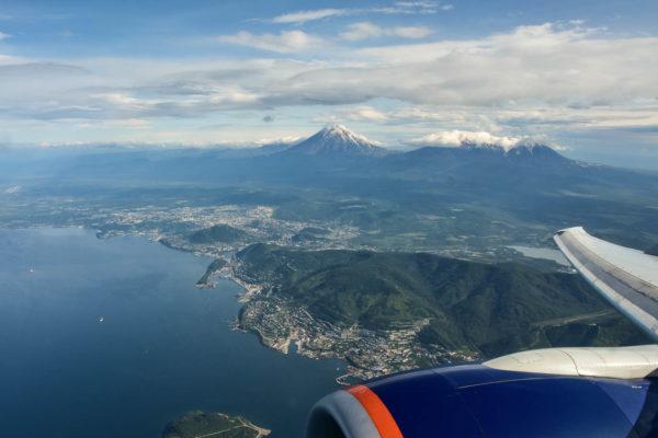 Bird view to Avachinskaya bay, volcanoes and Petropavlovsk city, the capital of Kamchatka peninsula.