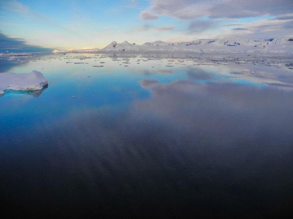 Sunset lights over Antarctic peninsula.
